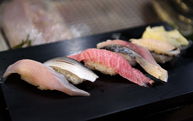 A plate of sushi, including tuna auctioned at Tsukiji Market, is served for a customer at a Sushi Zanmai restaurant, operated by Kiyomura K.K., in Tokyo, Japan, on Jan. 5, 2016. Kiyomura purchased a 200 kilogram (441 pound) tuna for 14 million yen ($117,000) at the year's first auction at Tsukiji Market. Photographer: Akio Kon/Bloomberg